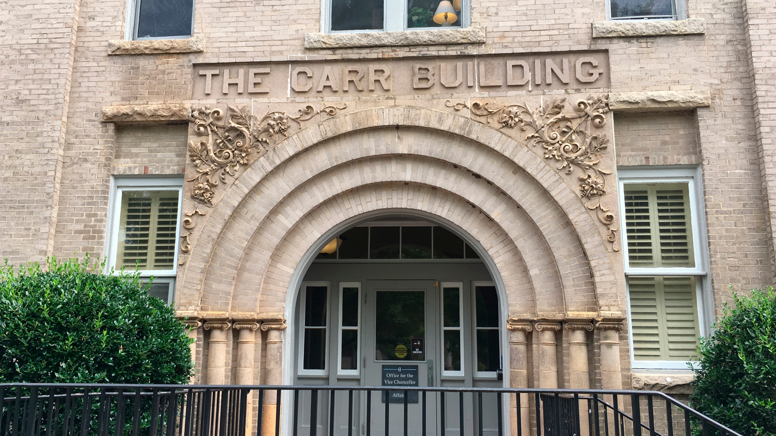 This Aug. 31, 2017 photo shows an entrance to the Carr Building on the campus of the University of North Carolina in Chapel Hill, N.C. The University of North Carolina-Chapel Hill Board of Trustees voted on Wednesday, July 29, 2020, to remove the names of Carr and three other men who have ties to white supremacy and racism from campus buildings. (AP Photo/Jonathan Drew)