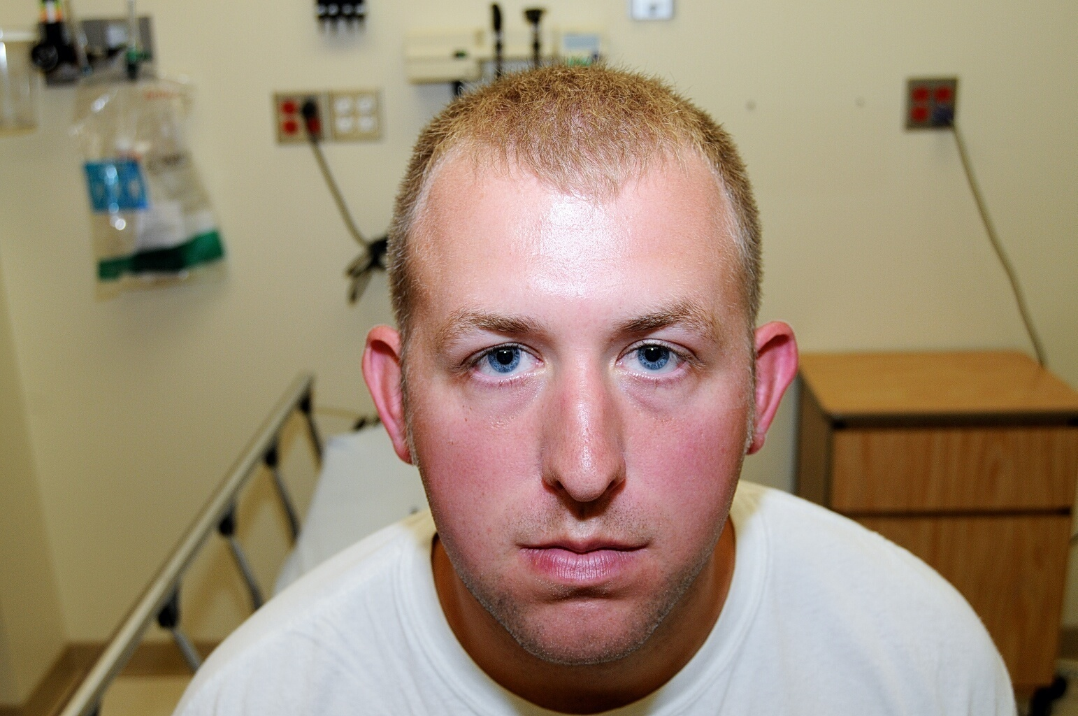 In this 2014 file photo provided by the St. Louis County Prosecuting Attorney's Office is Ferguson police officer Darren Wilson during his medical examination after he the fatal shooting of Michael Brown. St. Louis County's top prosecutor announced Thursday, July 30, 3030, that he will not charge Brown, the former police officer who fatally shot Michael Brown in Ferguson, Mo. (St. Louis County Prosecuting Attorney's Office via AP, File)