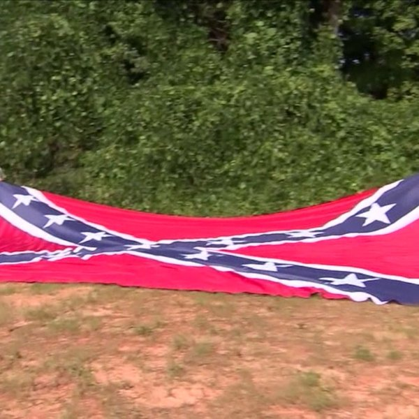 NC group angered by removal of statues hangs giant Confederate flag