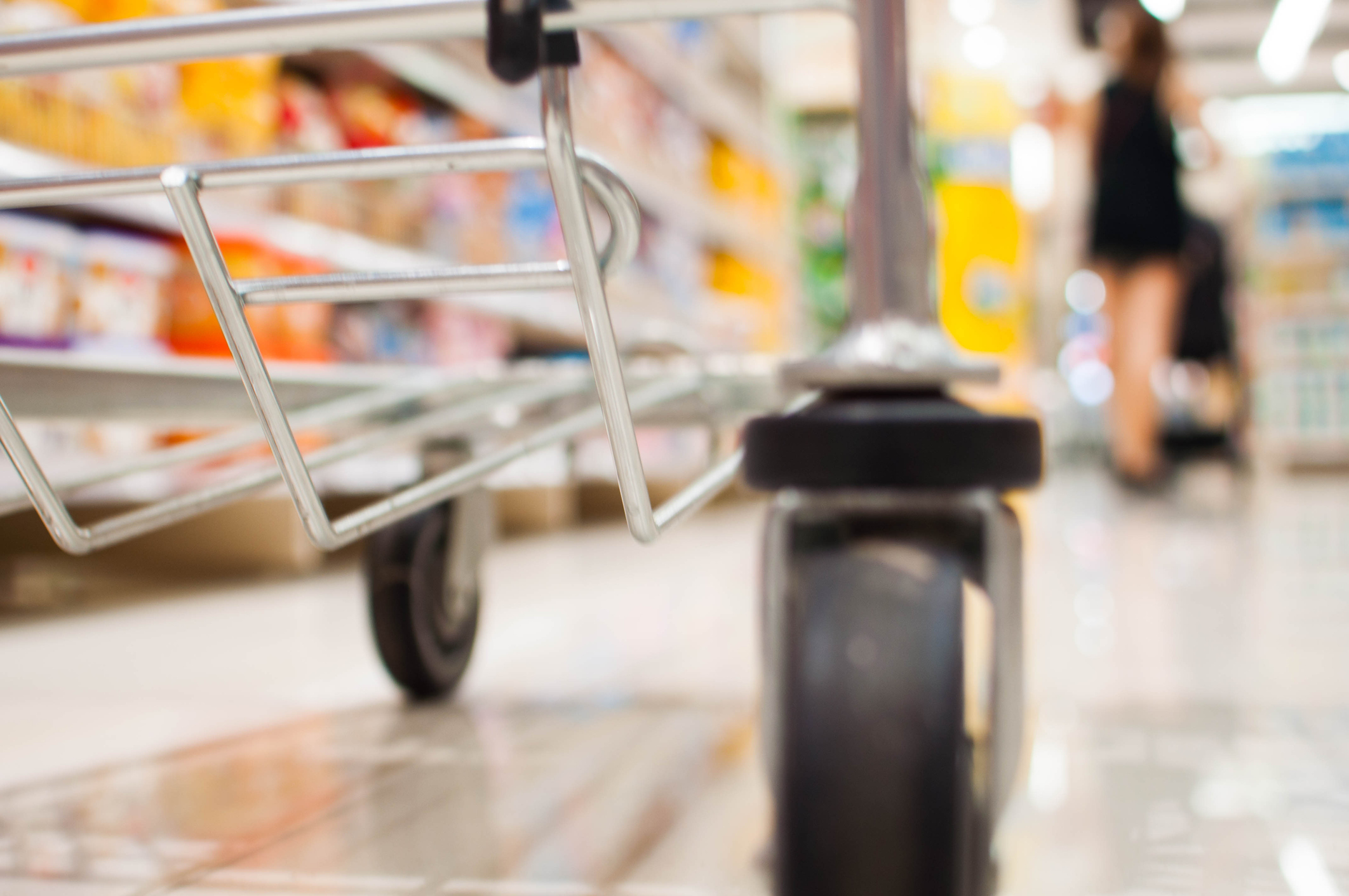 A low angle view of a shopping cart in the grocery store (Getty Images)