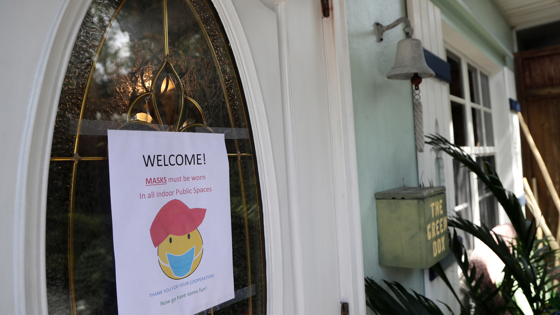 A sign advises guests to wear a face mask at the Island Bay Resort in Tavernier, in the Florida Keys, during the new coronavirus pandemic, Monday, June 1, 2020. (AP Photo/Lynne Sladky)