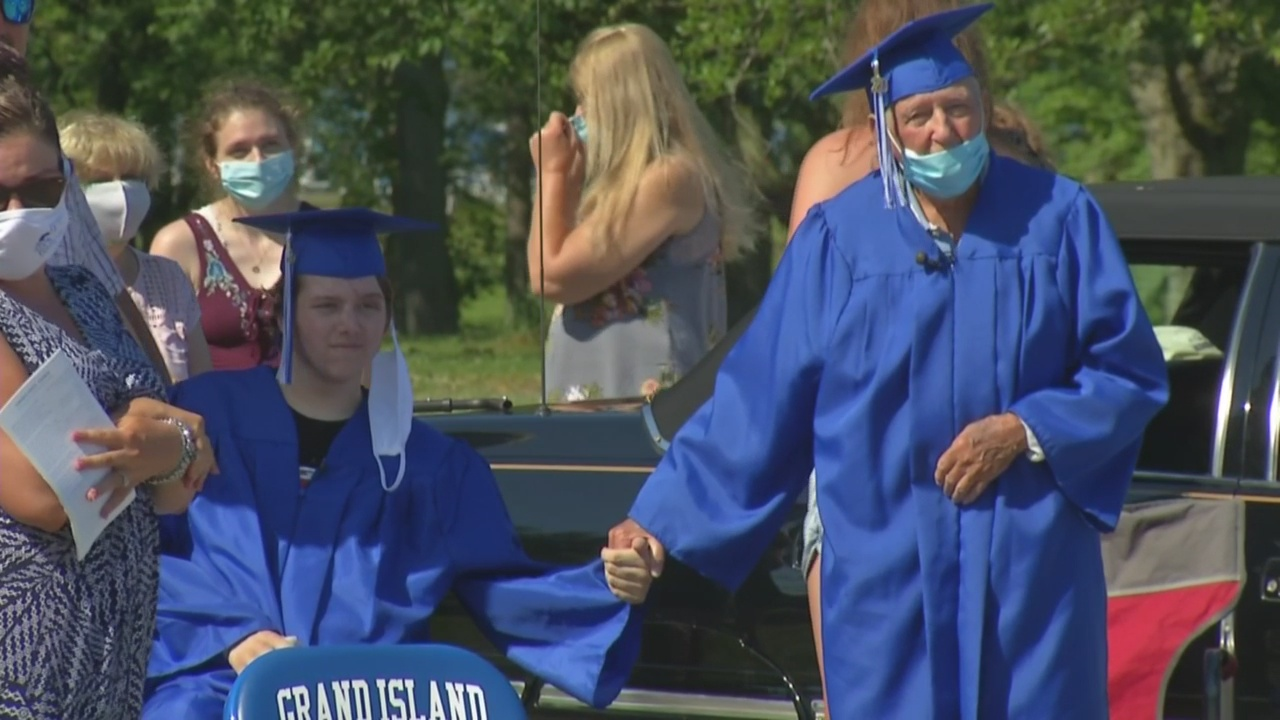 World War II Vet and grandson share graduation stage in a touching moment