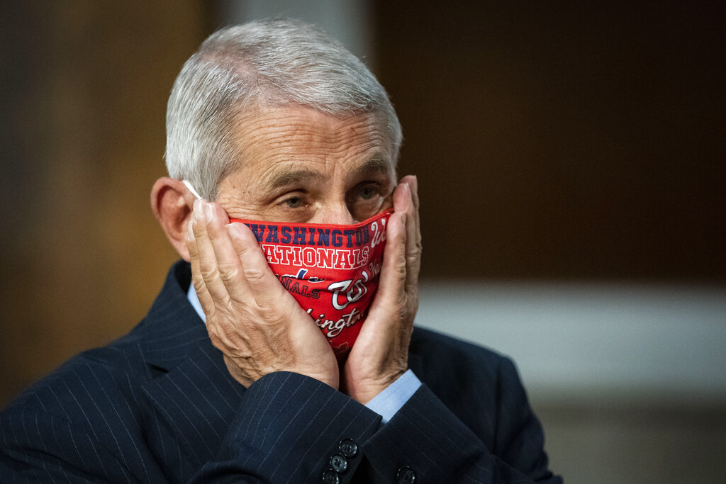 Director of the National Institute of Allergy and Infectious Diseases Dr. Anthony Fauci adjusts his protective face mask as he arrives for a Senate Health, Education, Labor and Pensions Committee hearing on Capitol Hill in Washington, Tuesday, June 30, 2020. (Al Drago/Pool via AP)