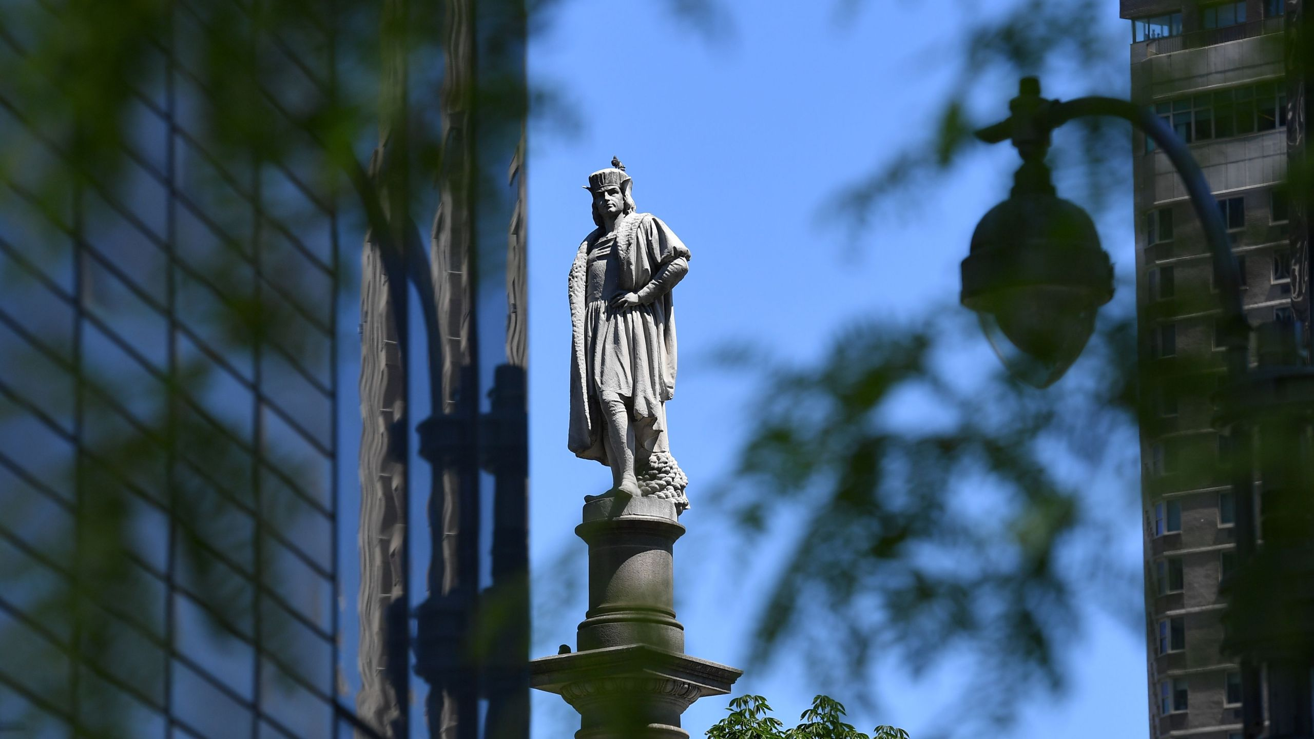"""The statue of Christopher Columbus on June 12, 2020, at Columbus Circle in New York City. Governor Andrew Cuomo defended the statue at the circle on June 11, 2020, as a symbol of """"Italian-American legacy"""" after calls to remove it mounted. - Statues of Christopher Columbus from Boston to Miami have been beheaded and vandalized as calls to remove sculptures commemorating colonizers and slavers sweep America on the back of anti-racism protests sparked by the death of George Floyd. (Photo by Angela Weiss / AFP) (Photo by ANGELA WEISS/AFP via Getty Images)"""