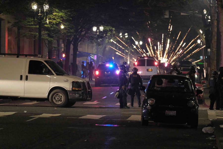 Police clear the streets near the Justice Center after a riot was declared in Portland, Ore., on July 4, 2020. (Photo by Alex Milan Tracy/Sipa USA)(Sipa via AP Images)