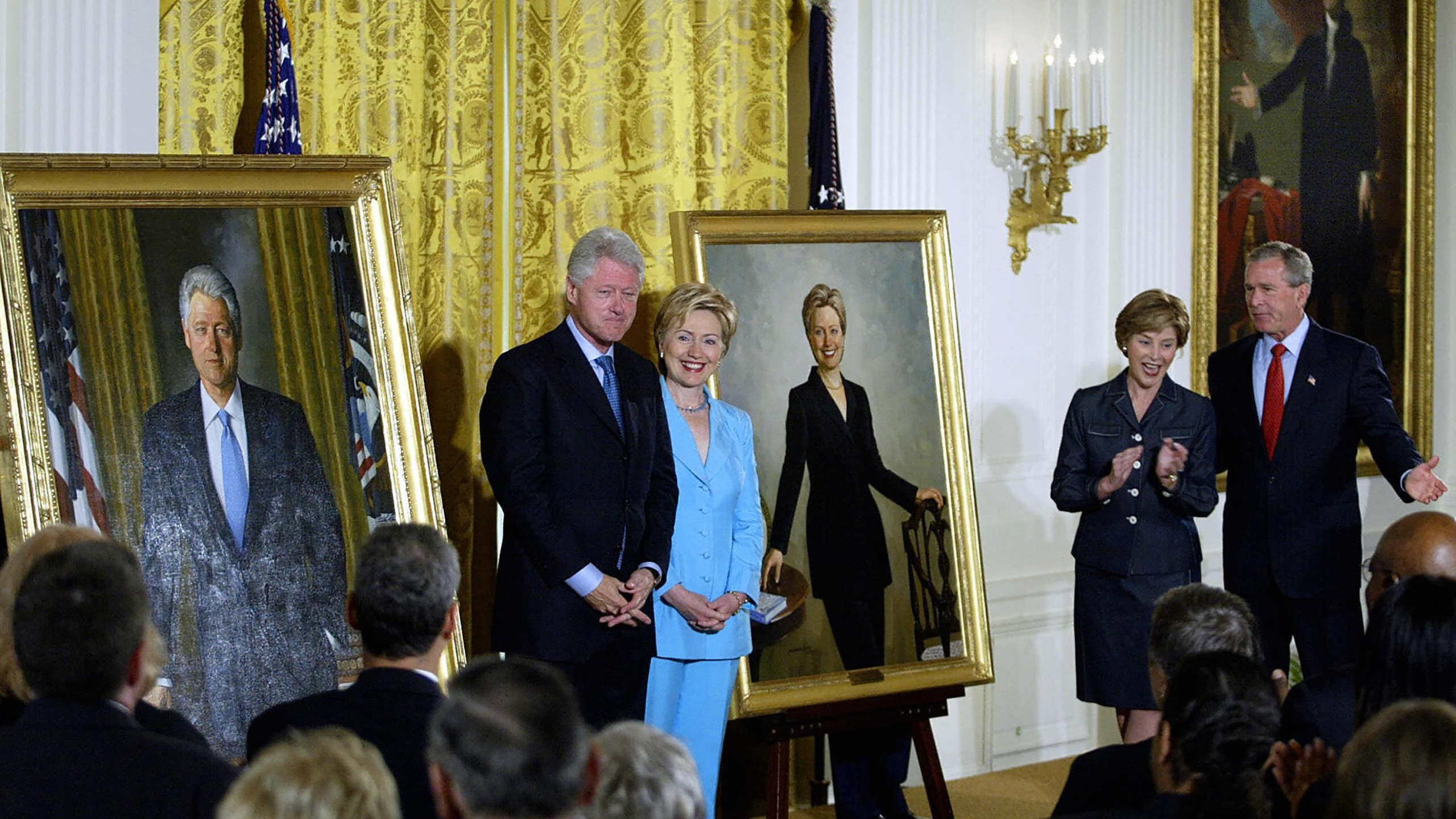 Former US President Bill Clinton (L) and Senator Hillary Clinton (2nd-L) stand by their offical White House portraits during the unveiling event hosted by President George W. Bush (R) and First Lady Laura Bush (2nd-R) 14 June, 2004, in the East Room of the White House in Washington, DC. (TIM SLOAN/AFP via Getty Images)