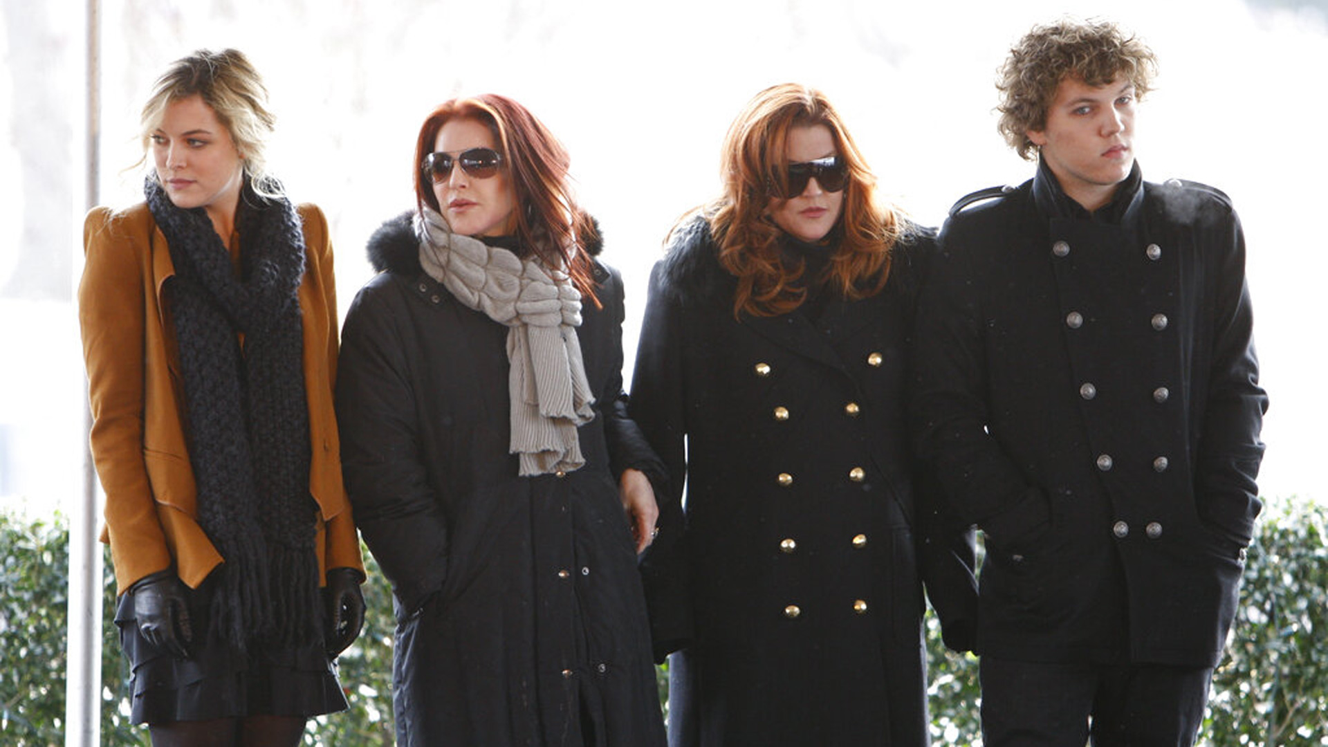 FILE - In this Jan. 8, 2010, file photo, Priscilla Presley, second from left, her daughter, Lisa Marie Presley, second from right, and Lisa Marie's children, Riley Keough, left, and Benjamin Keough, right, take part in a ceremony in Memphis, Tenn., commemorating Elvis Presley's 75th birthday. Keough has died. (AP Photo/Mark Humphrey, File)
