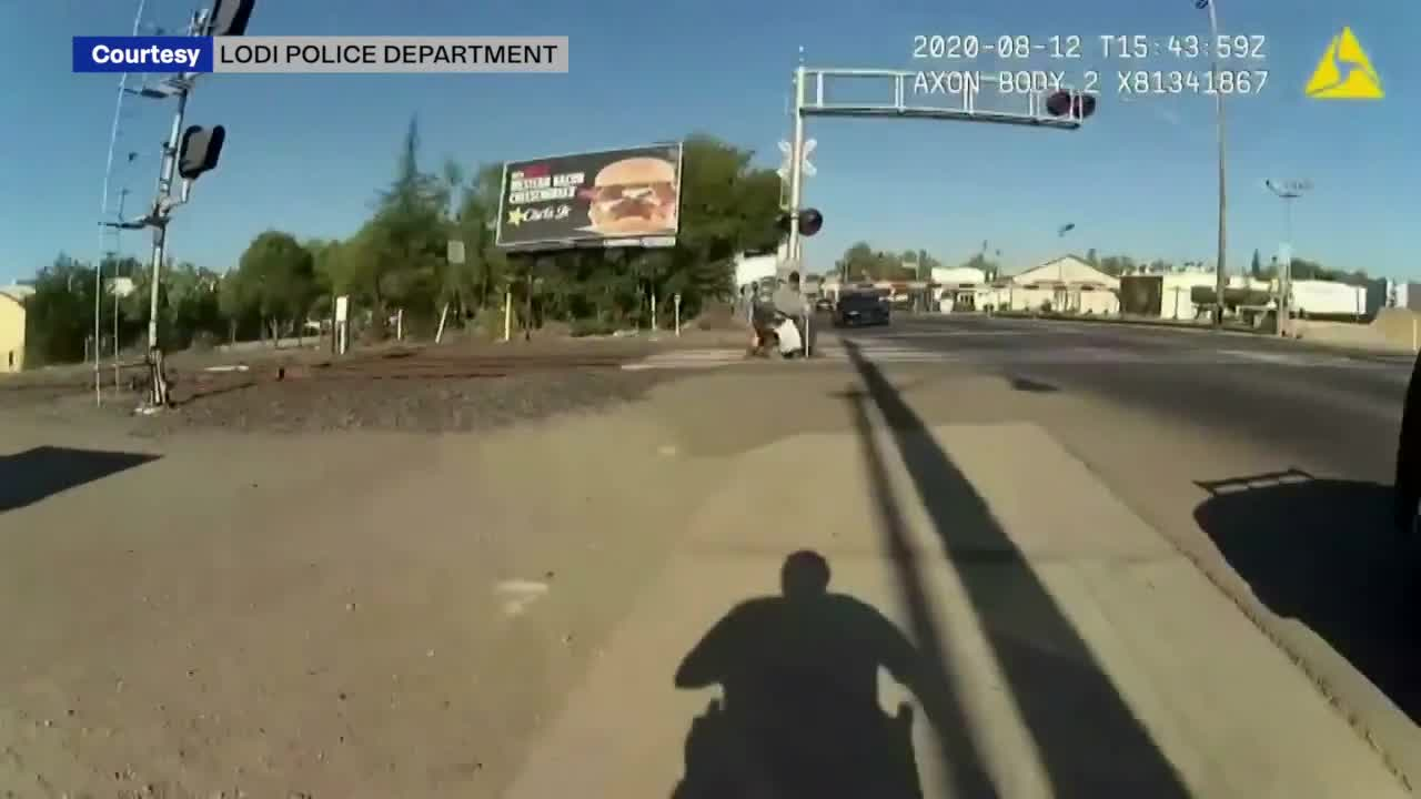 Police officer recounts 'surreal' experience saving man from oncoming train