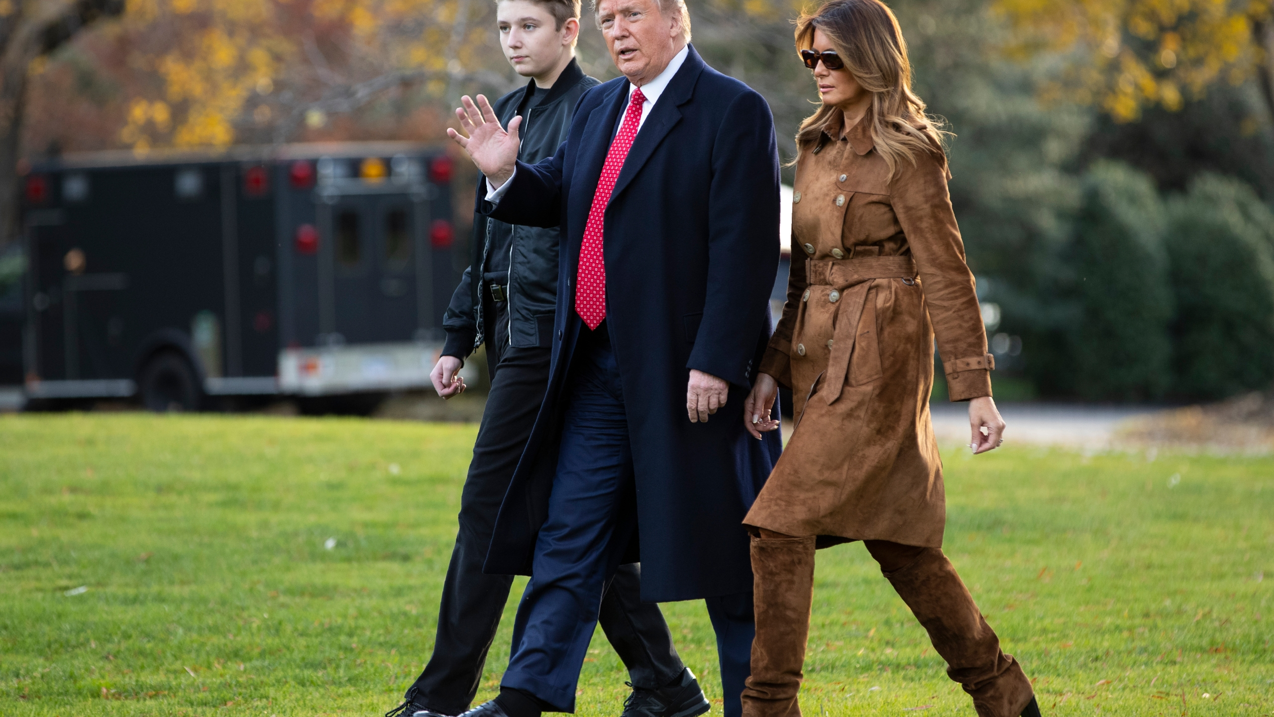 FILE - In this Tuesday, Nov. 26, 2019 file photo, President Donald Trump, first lady Melania Trump, and Barron Trump, walk to board Marine One on the South Lawn of the White House in Washington. President Donald Trump insists that schools reopen so students can go back to their classrooms, but the Maryland private school where his son Barron is enrolled is among those under county orders to stay closed. (AP Photo/ Evan Vucci, File)