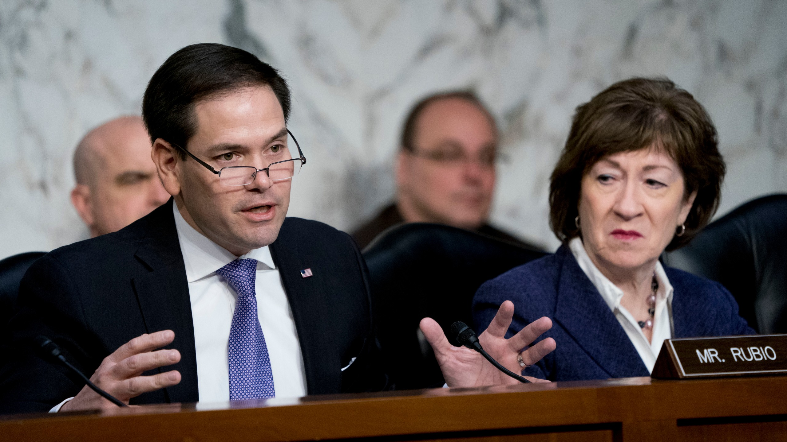 FILE - In this March 21, 2018 file photo, Sen. Marco Rubio, R-Fla., left, accompanied by Sen. Susan Collins, R-Maine,right, speaks before a Senate Intelligence Committee hearing on election security on Capitol Hill in Washington. The Senate intelligence committee has concluded that the Kremlin launched an aggressive effort to interfere in the 2016 presidential contest on behalf of Donald Trump. The Republican-led panel on Tuesday released its fifth and final report in its investigation into election interference. (AP Photo/Andrew Harnik)