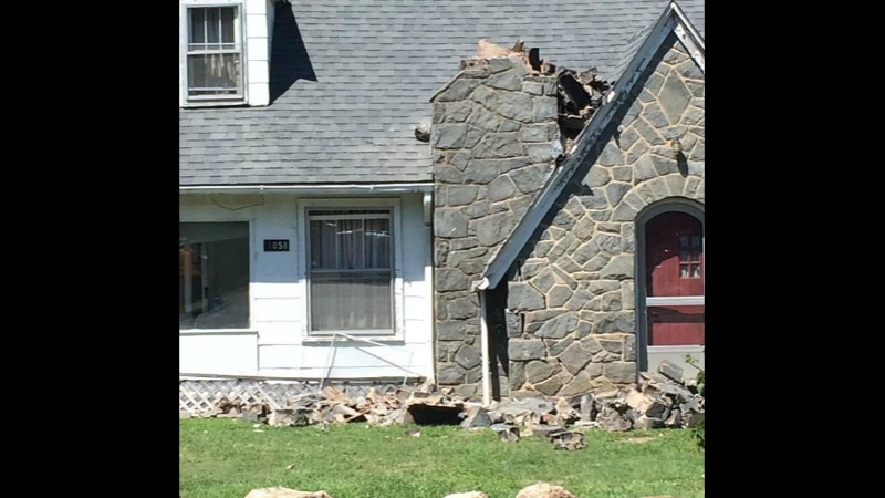 Earthquake Damage: Chimney collapsed at Little River Bridge. Highway 21 south of Sparta, NC