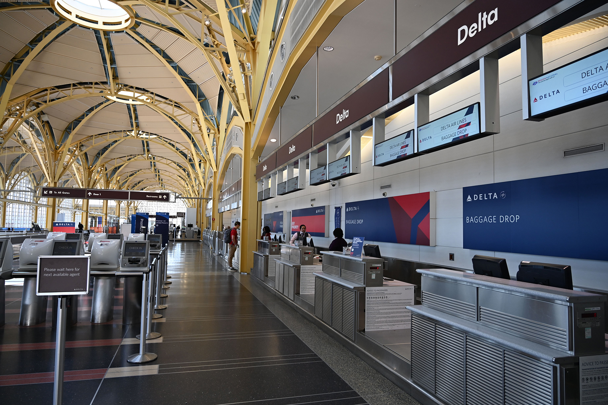 A view of empty Delta checkin counters at Washington National Airport (DCA) on April 11, 2020 in Arlington, Virginia. - Many flights are canceled due to the spread of the Coronavirus over the US. (Photo by Daniel SLIM / AFP) (Photo by DANIEL SLIM/AFP via Getty Images)