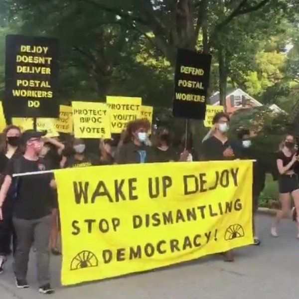 Protesters rally outside of Postmaster General Louis DeJoy's home in Greensboro