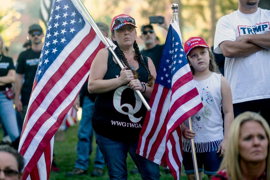 Leila, 8, and mom Stacey, who declined to give their last names, attend a memorial for Aaron J. Danielson on Saturday, Sept. 5, 2020, in Vancouver, Wash. Danielson, a supporter of the conservative group Patriot Prayer, was fatally shot in August as supporters of President Donald Trump and Black Lives Matter protesters clashed in Portland, Ore. (AP Photo/Noah Berger)