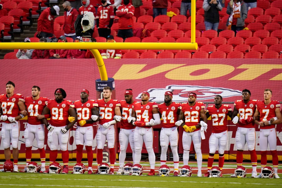 FILE - In this Thursday, Sept. 10, 2020 file photo, Kansas City Chiefs players stand for a presentation on social justice before an NFL football game against the Houston Texans Thursday, Sept. 10, 2020, in Kansas City, Mo. The NFL's new stance encouraging players to take a stand against racial injustice got its first test as some fans of the Super Bowl champion Kansas City Chiefs booed during a moment of silence to promote the cause, touching off a fresh debate on how players should use their voice. (AP Photo/Charlie Riedel, File)