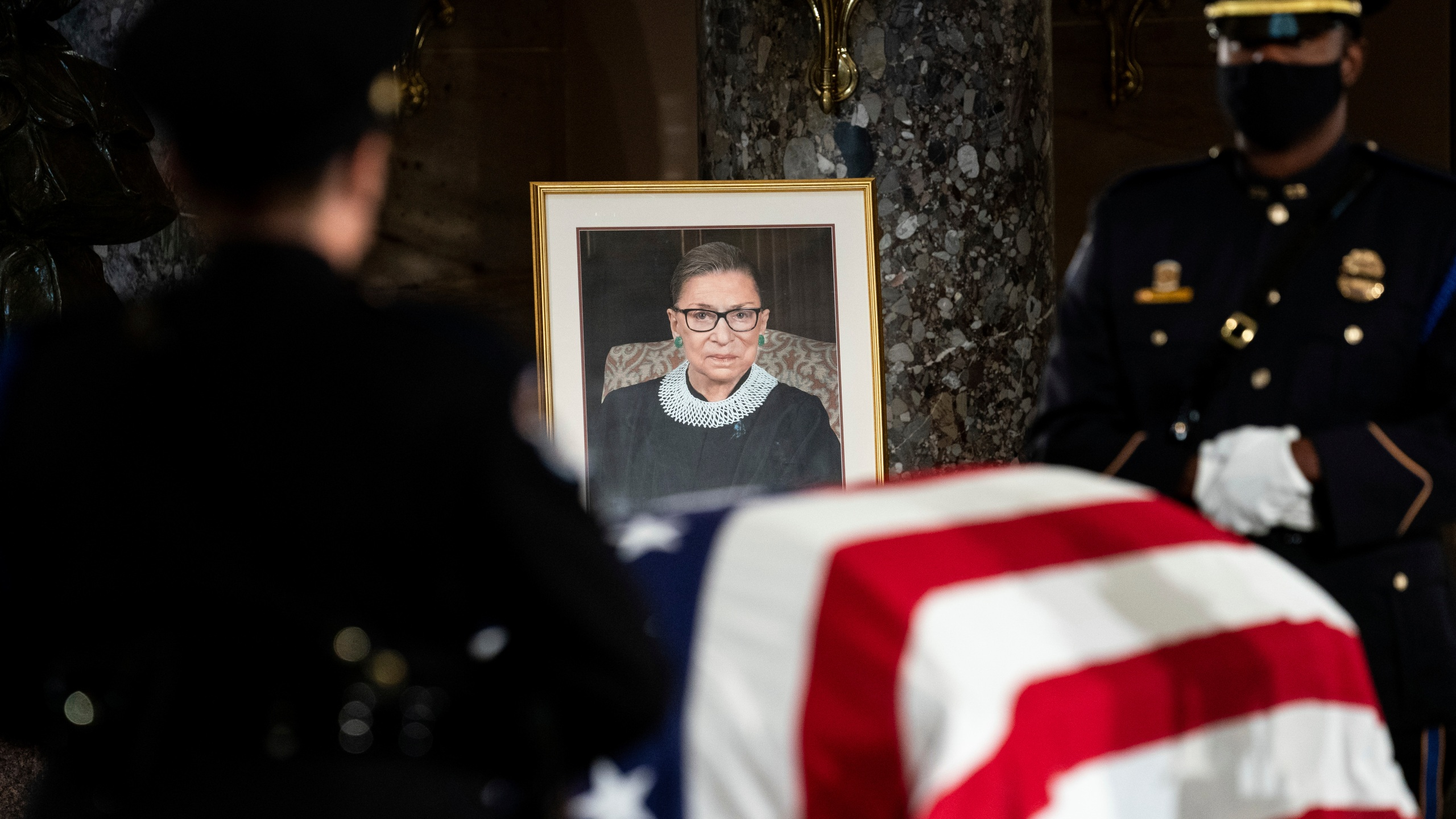 The flag-draped casket of Justice Ruth Bader Ginsburg lies in state in the U.S. Capitol on Friday, Sept. 25, 2020. Ginsburg died at the age of 87 on Sept. 18 and is the first women to lie in state at the Capitol. (Erin Schaff/The New York Times via AP, Pool)