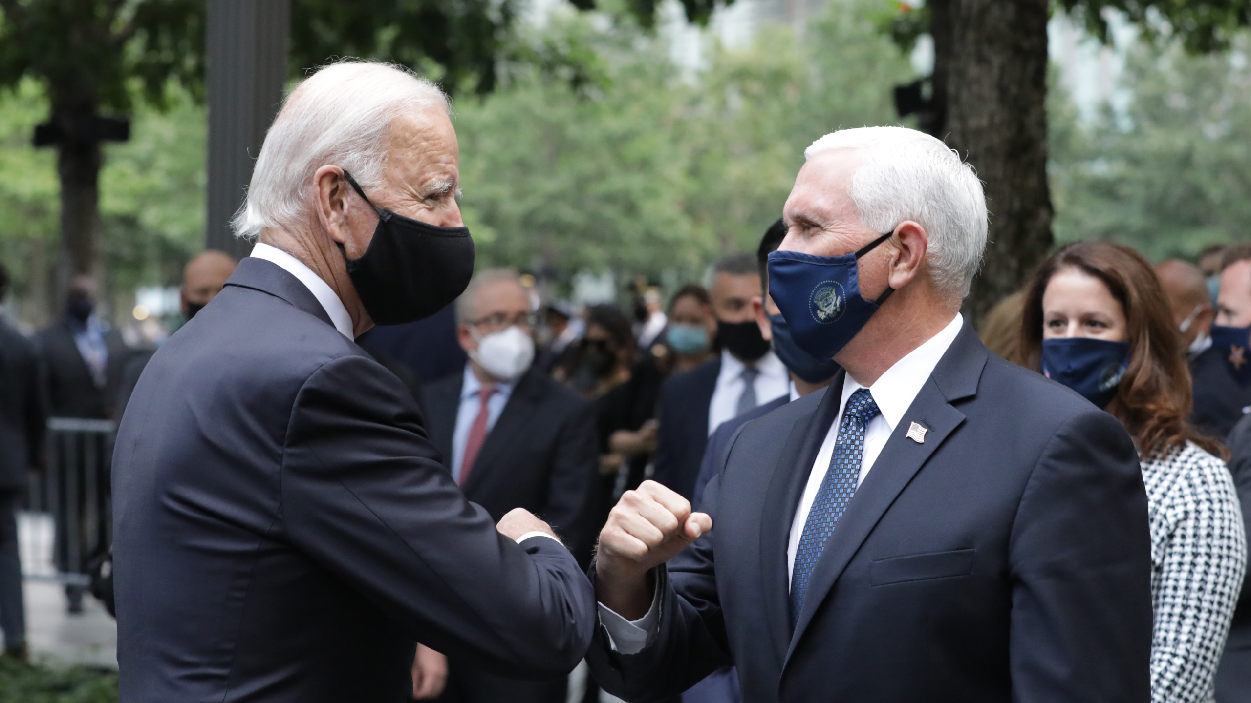 NEW YORK, NEW YORK - SEPTEMBER 11: Democratic presidential nominee Joe Biden (L) and U.S. Vice President Mike Pence (R) greet each other during a 9/11 memorial service at the National September 11 Memorial and Museum on September 11, 2020 in New York City. The ceremony to remember those who were killed in the terror attacks 19 years ago will be altered this year in order to adhere to safety precautions around COVID-19 transmission. (Photo by Amr Alfiky - Pool/Getty Images)