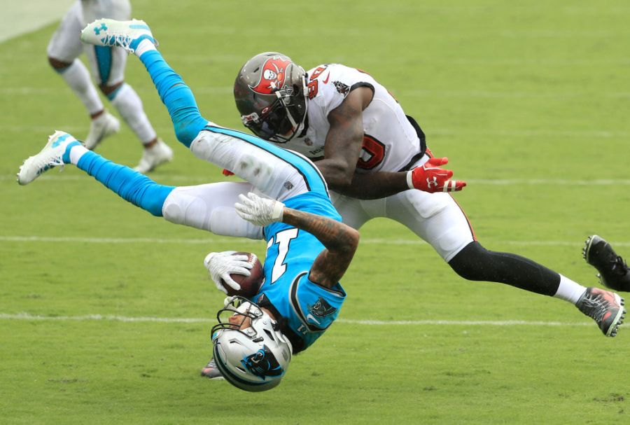 TAMPA, FLORIDA - SEPTEMBER 20: Robby Anderson #11 of the Carolina Panthers is upended as he is tackled by Jason Pierre-Paul #90 and Sean Murphy-Bunting #23 (not pictured) of the Tampa Bay Buccaneers during the third quarter at Raymond James Stadium on September 20, 2020 in Tampa, Florida. (Photo by Mike Ehrmann/Getty Images)