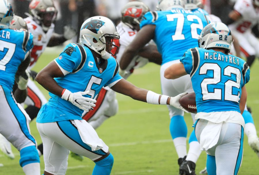 TAMPA, FLORIDA - SEPTEMBER 20: Teddy Bridgewater #5 of the Carolina Panthers looks to hand off the ball to Christian McCaffrey #22 during the second half against the Tampa Bay Buccaneers at Raymond James Stadium on September 20, 2020 in Tampa, Florida. (Photo by Mike Ehrmann/Getty Images)