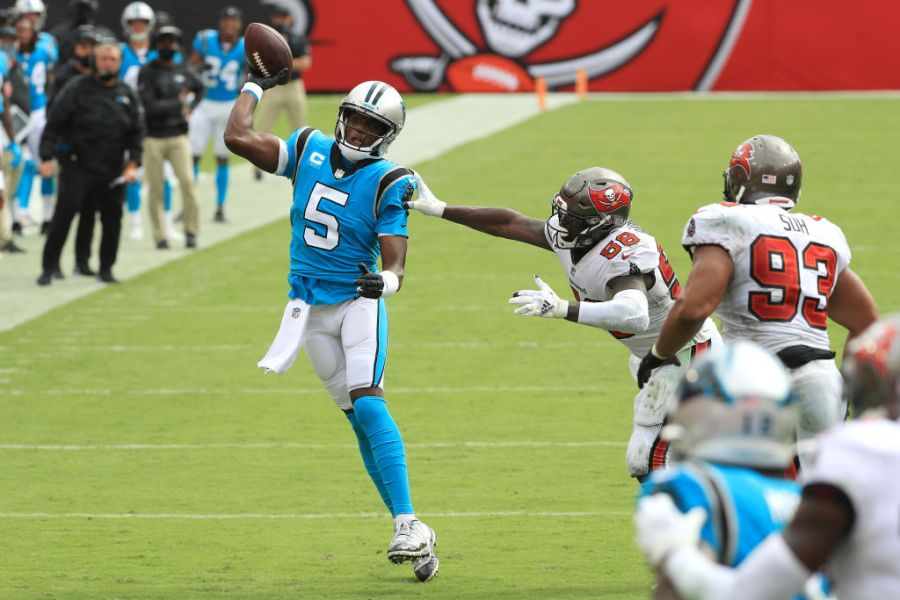 TAMPA, FLORIDA - SEPTEMBER 20: Teddy Bridgewater #5 of the Carolina Panthers throws away the ball as he is pressured by Shaquil Barrett #58 of the Tampa Bay Buccaneers during the second half at Raymond James Stadium on September 20, 2020 in Tampa, Florida. (Photo by Mike Ehrmann/Getty Images)