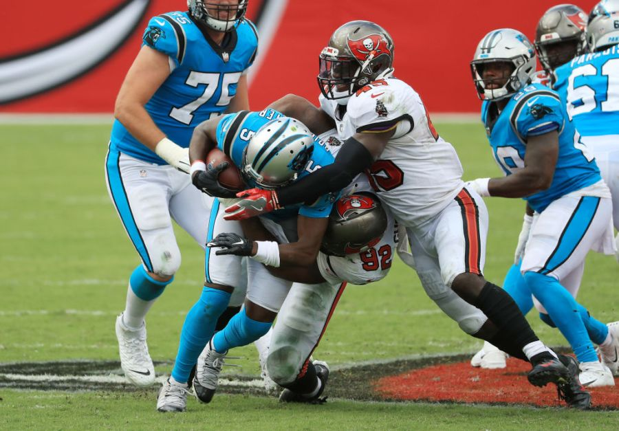 TAMPA, FLORIDA - SEPTEMBER 20: William Gholston #92 of the Tampa Bay Buccaneers sacks Teddy Bridgewater #5 of the Carolina Panthers during the second half at Raymond James Stadium on September 20, 2020 in Tampa, Florida. (Photo by Mike Ehrmann/Getty Images)