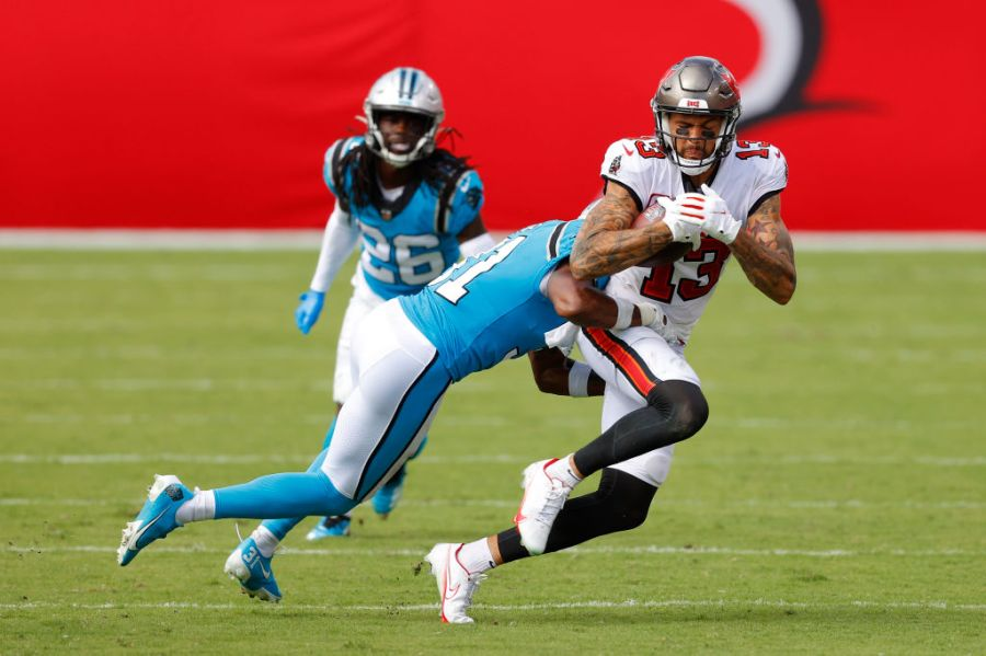 TAMPA, FLORIDA - SEPTEMBER 20: Juston Burris #31 of the Carolina Panthers tackles Mike Evans #13 of the Tampa Bay Buccaneers during the second half at Raymond James Stadium on September 20, 2020 in Tampa, Florida. (Photo by Mike Ehrmann/Getty Images)