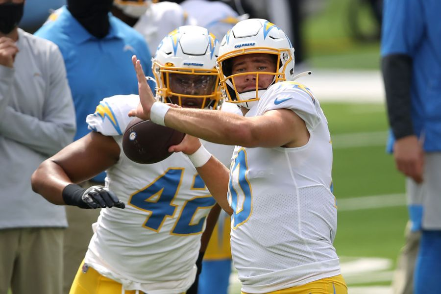 INGLEWOOD, CALIFORNIA - SEPTEMBER 27: Justin Herbert #10 of the Los Angeles Chargers throws a pass prior to a game against the Carolina Panthers at SoFi Stadium on September 27, 2020 in Inglewood, California. (Photo by Sean M. Haffey/Getty Images)