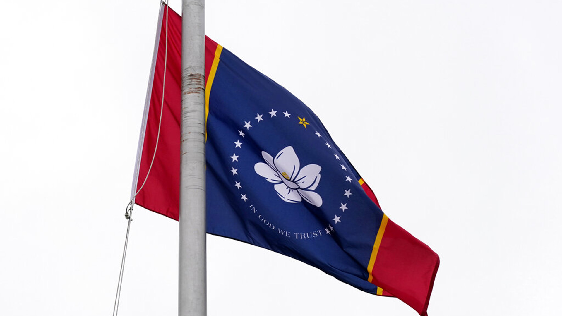 One of five final designs for the new Mississippi state flag flutters in the breeze, outside the Old Capitol Museum in Jackson, Miss., Aug. 25, 2020, in Jackson, Miss. In late June, Mississippi legislators voted to retire the last state flag to include the Confederate battle emblem, which is broadly condemned as racist. All five were flown outside the museum for viewing. The Mississippi State Flag Commission narrowed their choices to two flags, of which this is one. They will reconvene in September to make their final choice. (AP Photo/Rogelio V. Solis)