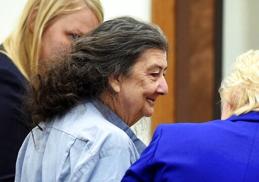 FILE - In this Sept. 8, 2014, file photo, Cathy Woods appears in Washoe District court in Reno, Nev. County commissioners in Nevada have agreed to a $3 million settlement with Woods, who spent 35 years in prison for a murder she didn't commit before she was exonerated by DNA evidence tied to a crime-scene cigarette butt. The National Registry of Exonerations says Cathy Woods was the longest-ever wrongfully incarcerated woman in U.S. history. The Washoe County Commission approved the settlement Tuesday, Aug. 27, 2019. (Andy Barron/The Reno Gazette-Journal via AP, File)
