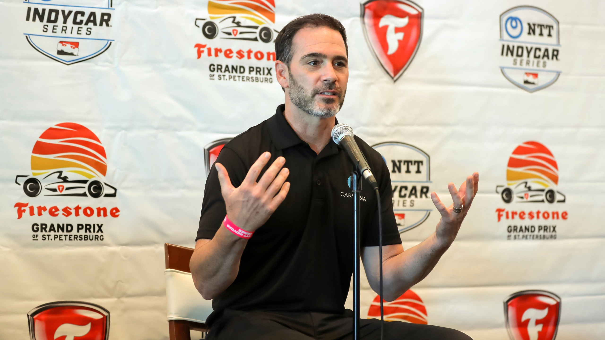 Jimmie Johnson speaks about joining the team of Chip Ganassi for the IndyCar series at a press conference during the IndyCar race weekend Saturday, Oct. 24, 2020, in St. Petersburg, Fla. (AP Photo/Mike Carlson)