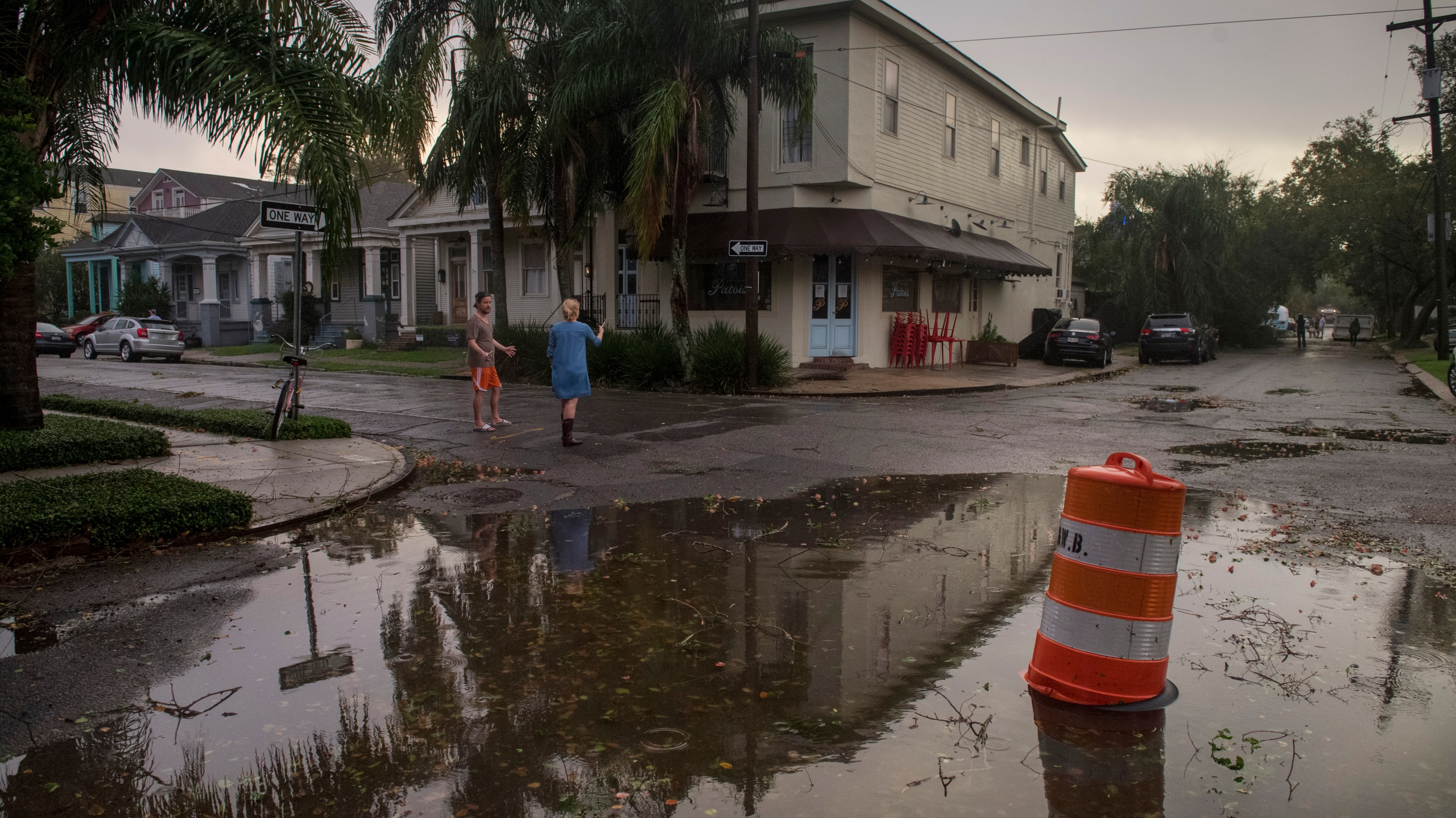 Residents come out to assess the damage from Hurricane Zeta on Wednesday, Oct. 28, 2020, near the restaurant Patois in New Orleans. (Chris Granger/The Times-Picayune/The New Orleans Advocate via AP)