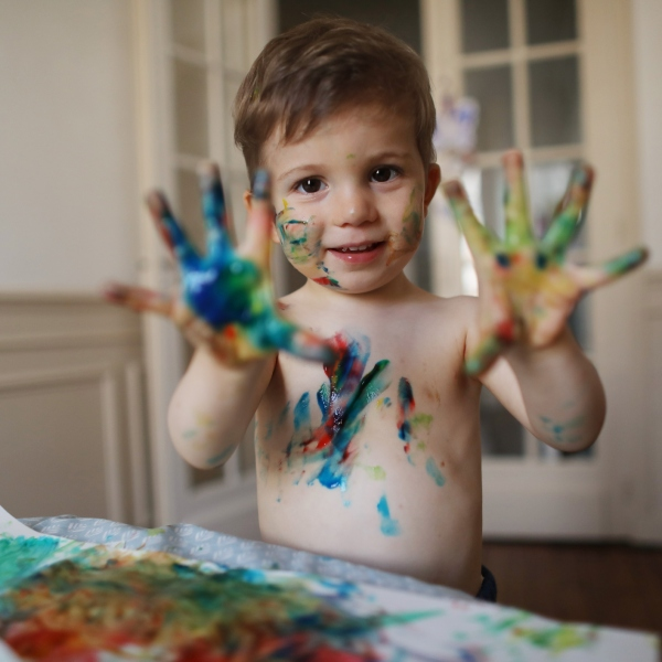 Boy finger painting (Getty Images)