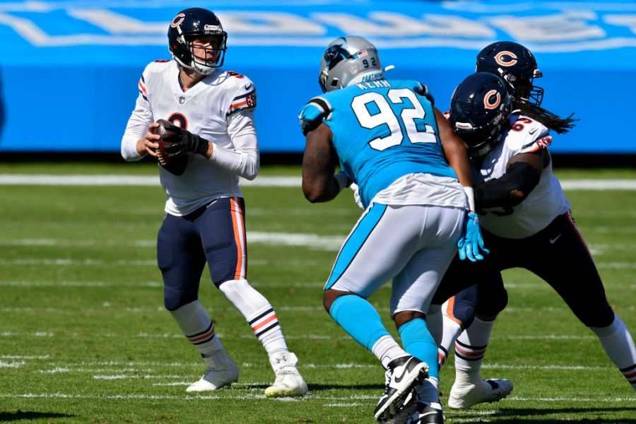CHARLOTTE, NORTH CAROLINA - OCTOBER 18: Nick Foles #9 of the Chicago Bears drops back to pass in the first quarter against the Carolina Panthers at Bank of America Stadium on October 18, 2020 in Charlotte, North Carolina. (Photo by Grant Halverson/Getty Images)