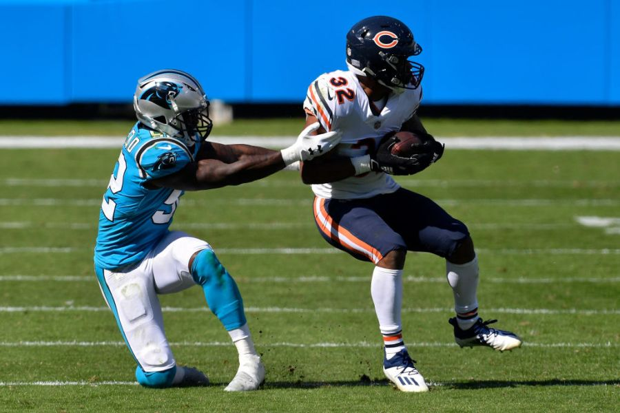 CHARLOTTE, NORTH CAROLINA - OCTOBER 18: David Montgomery #32 of the Chicago Bears runs with the ball while being tackled by Tahir Whitehead #52 of the Carolina Panthers in the second quarter at Bank of America Stadium on October 18, 2020 in Charlotte, North Carolina. (Photo by Grant Halverson/Getty Images)