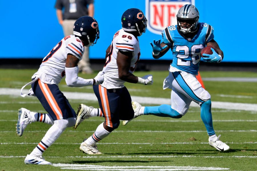 CHARLOTTE, NORTH CAROLINA - OCTOBER 18: Mike Davis #28 of the Carolina Panthers runs with the ball while being chased by Roquan Smith #58 of the Chicago Bears in the second quarter at Bank of America Stadium on October 18, 2020 in Charlotte, North Carolina. (Photo by Grant Halverson/Getty Images)