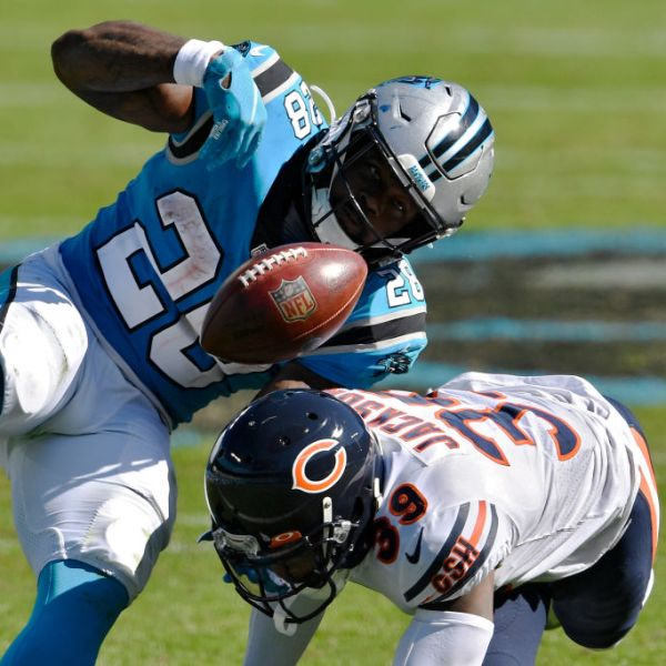 CHARLOTTE, NORTH CAROLINA - OCTOBER 18: Eddie Jackson #39 of the Chicago Bears forces a fumble against Mike Davis #28 of the Carolina Panthers in the third quarter at Bank of America Stadium on October 18, 2020 in Charlotte, North Carolina. (Photo by Grant Halverson/Getty Images)