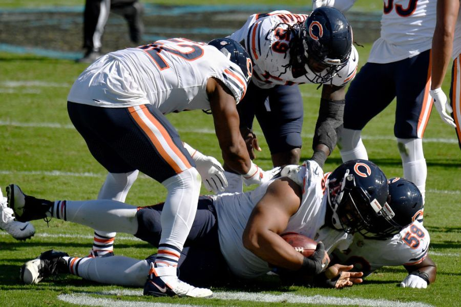 CHARLOTTE, NORTH CAROLINA - OCTOBER 18: Akiem Hicks #96 of the Chicago Bears celebrates after recovering a fumble in the third quarter against the Carolina Panthers at Bank of America Stadium on October 18, 2020 in Charlotte, North Carolina. (Photo by Grant Halverson/Getty Images)