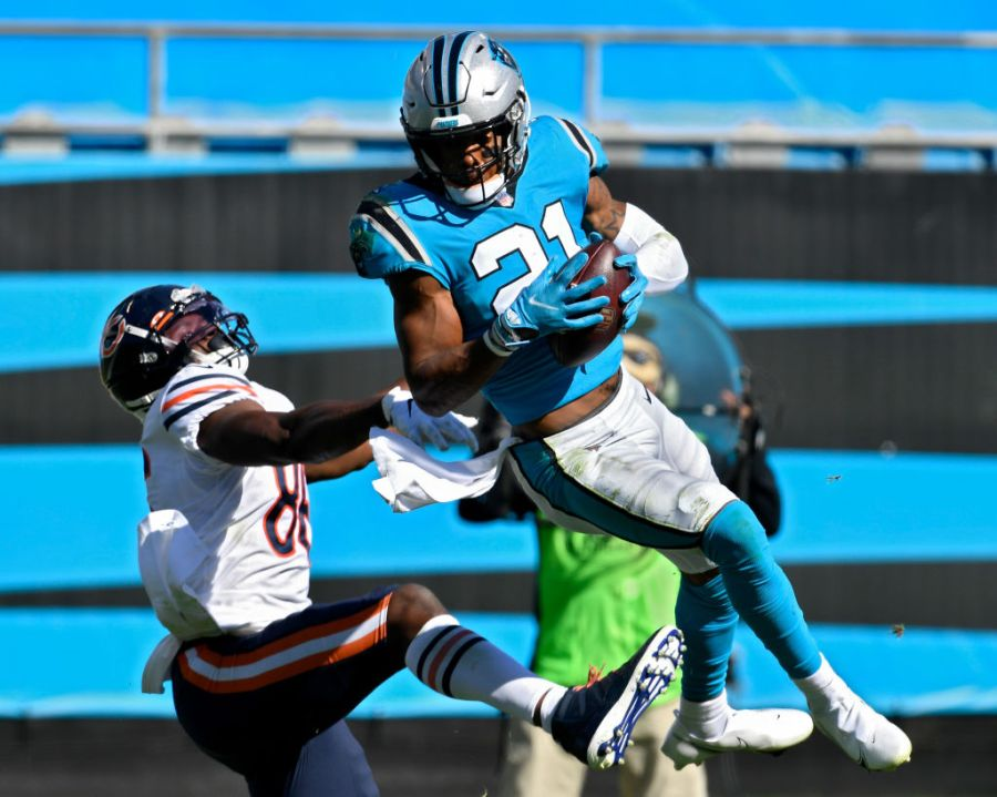 CHARLOTTE, NORTH CAROLINA - OCTOBER 18: Jeremy Chinn #21 of the Carolina Panthers intercepts a pass in front of Demetrius Harris #86 of the Chicago Bears in the third quarter at Bank of America Stadium on October 18, 2020 in Charlotte, North Carolina. (Photo by Grant Halverson/Getty Images)