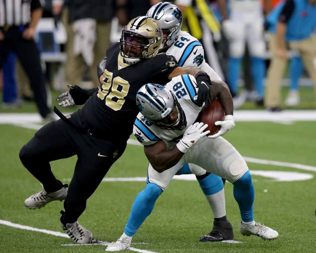 NEW ORLEANS, LOUISIANA - OCTOBER 25: Mike Davis #28 of the Carolina Panthers runs with the ball while being tackled by Sheldon Rankins #98 of the New Orleans Saints in the second quarter at the Mercedes-Benz Superdome on October 25, 2020 in New Orleans, Louisiana. (Photo by Jonathan Bachman/Getty Images)