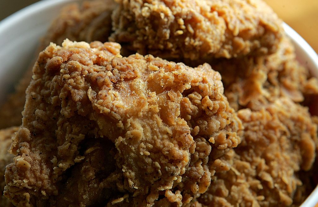 SAN RAFAEL, CA - OCTOBER 30: A bucket of KFC Extra Crispy fried chicken is displayed October 30, 2006 in San Rafael, California. KFC is phasing out trans fats and plans to use zero trans fat soybean oil for cooking of their Original Recipe and Extra Crispy fried chicken as well as other menu items. KFC expects to have all of its 5,500 restaurants in the U.S. switched to the new oil by April 2007. (Photo Illustration by Justin Sullivan/Getty Images)