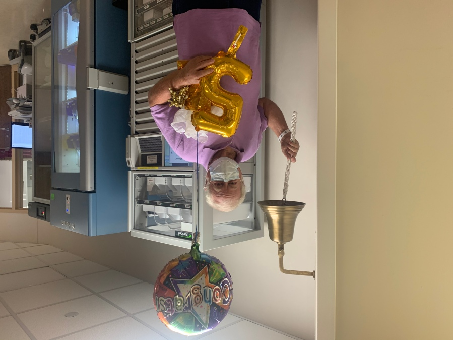 Earl Groce, 72, rings the bell to celebrate his five year survival of stage IV pancreatic cancer at the Comprehensive Cancer Center at Wake Forest Baptist Medical Center. The celebration also marked his 116th chemotherapy treatment.