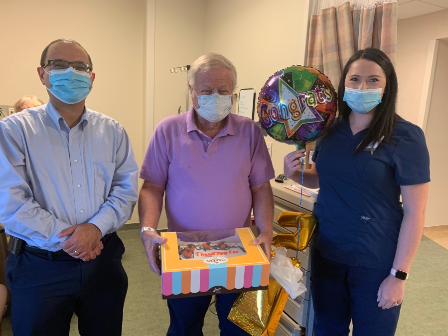 Left to right: George Yacoub, M.D., assistant professor of hematology and oncology, Groce and Kristin Houston, P.A. Groce brought a cake as a 'thank you' to his care team.