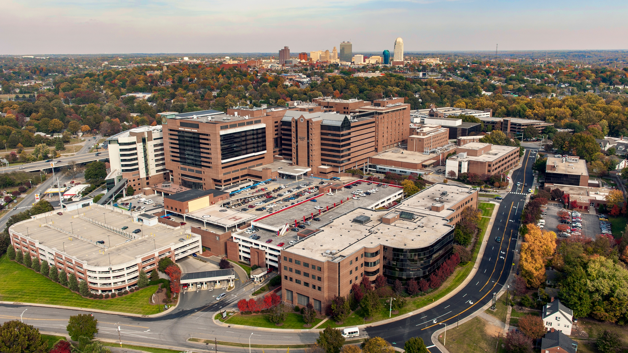 Aerial view of Wake Forest Baptist Medical Center with downtown Winston-Salem in the background, 2014. (Courtesy of Atrium Health)