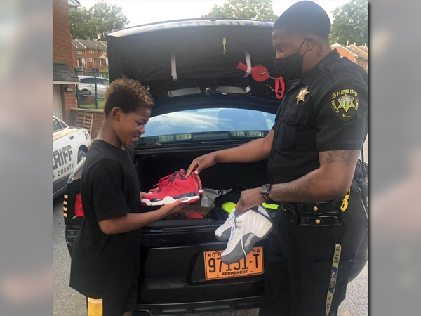Forsyth County deputy gives teen new pair of shoes