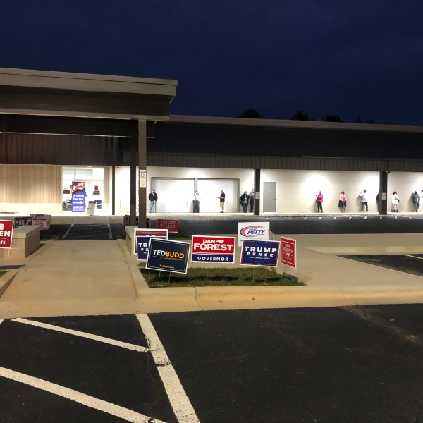 Randolph County voters line up outside of polling place before early voting begins