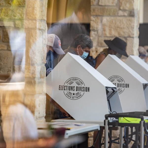 People cast their ballots at a polling location on October 13, 2020 in Austin, Texas. (Photo by Sergio Flores/Getty Images)