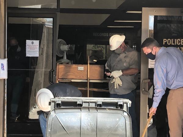 Minivan crashes into Burlington Police Department building; suspect in custody