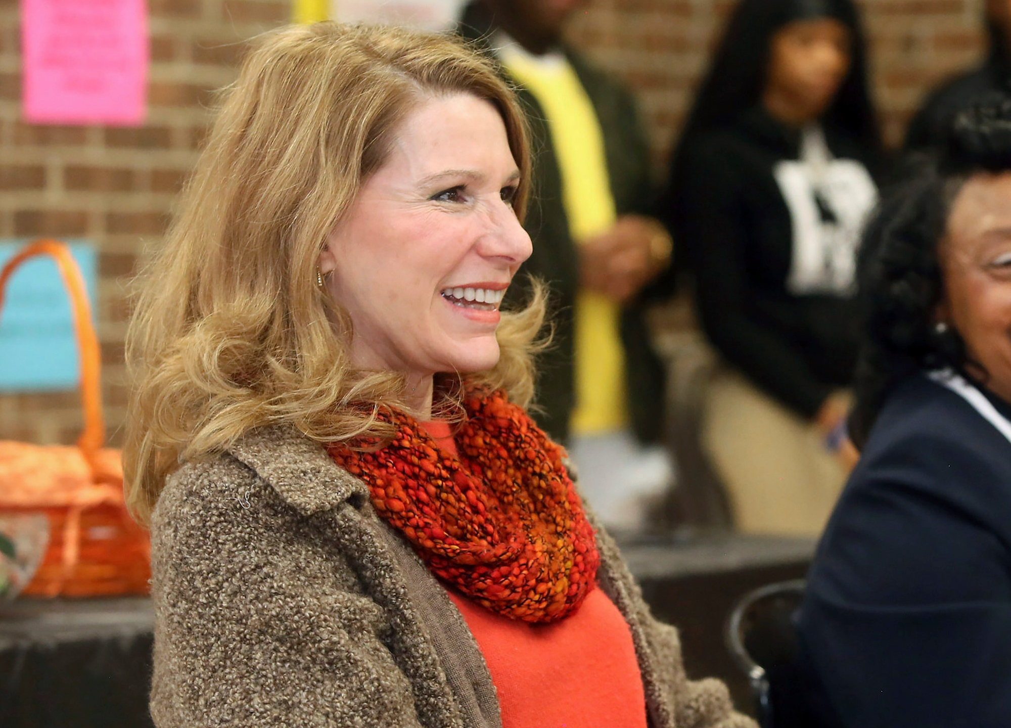 "FILE - In this March 4, 2019 file photo, Kristin Cooper, first lady of North Carolina, laughs as she responds to a question from a North Edgecombe High School student while visiting the high school as a part of National School Breakfast Week in Leggett, N.C. Cooper apologized Thursday, Nov. 5, 2020, through an emailed statement from her spokesperson to The News & Observer after a screenshot of her saying she ""flipped off"" supporters of President Donald Trump during a rally in the state was circulated on social media. (Alan Campbell/Rocky Mount Telegram via AP)"
