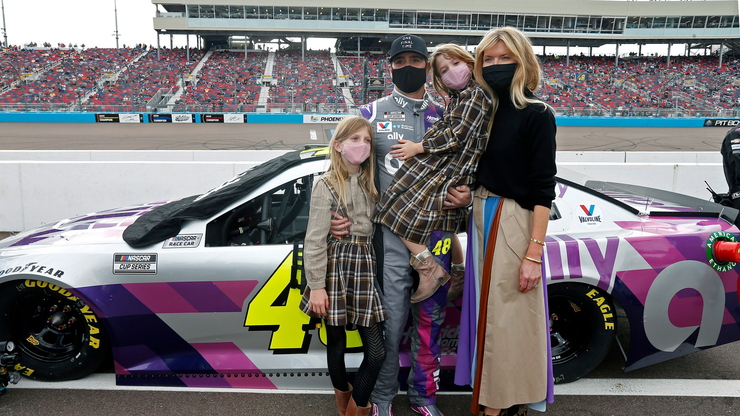 Jimmie Johnson, center, stands with his family on pit road prior to a NASCAR Cup Series auto race at Phoenix Raceway, Sunday, Nov. 8, 2020, in Avondale, Ariz. (AP Photo/Ralph Freso)