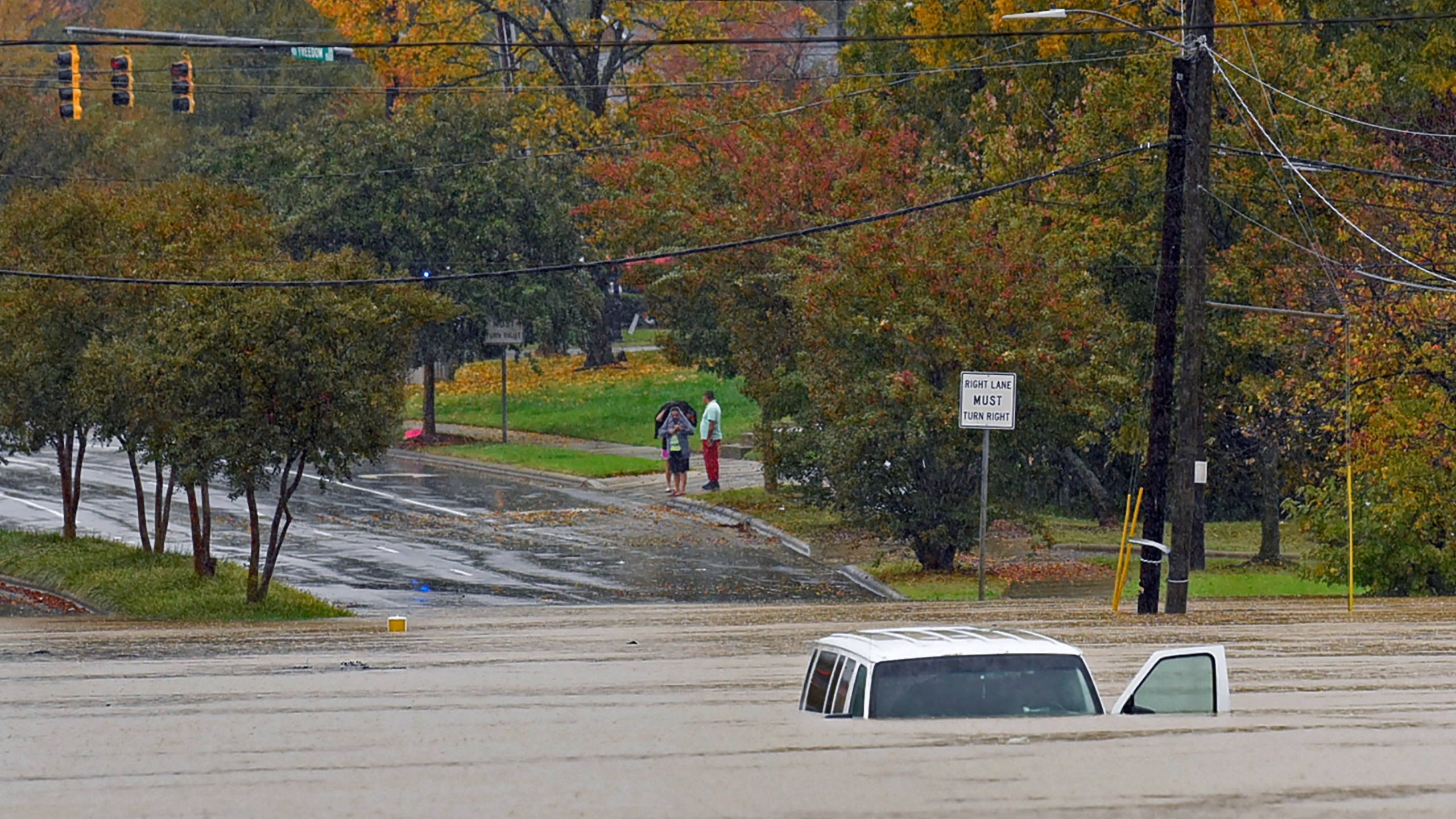 A vehicle is submerged in floodwater on Freedom Drive in Charlotte, N.C., Thursday, Nov. 12, 2020. Tropical Storm Eta dumped blustery rain across north Florida after landfall Thursday morning north of the heavily populated Tampa Bay area, and then sped out into the Atlantic off of the neighboring coasts of Georgia and the Carolinas. (Jeff Siner/The Charlotte Observer via AP)